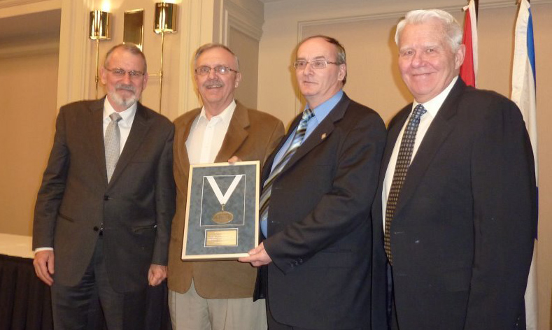 (Above left to right: John Gaventa, Director, Coady International Institute; Larry Drouin, President, Tignish Credit Union; Louis Shea, General Manager, Tignish Credit Union; Dave MacLean, Board Chair, Atlantic Central)