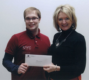 Winner Cody Wells, Computer Networking Technology Program, accepts Atlantic Credit Unions bursary cheque from Jeanette Wakelin, Director of Training and Education, Atlantic Central