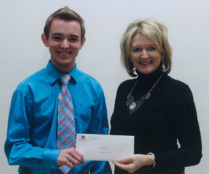 Winner Darien MacDonald, Marketing and Advertising Program, accepts Atlantic Credit Unions bursary cheque from Jeanette Wakelin, Director of Training and Education, Atlantic Central