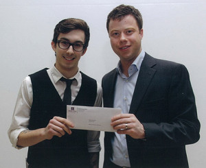 Winner Matthew Hannah, Culinary Arts Program, accepts Atlantic Credit Unions bursary cheque from Quentin Bevan, Board Chair, Holland College Foundation