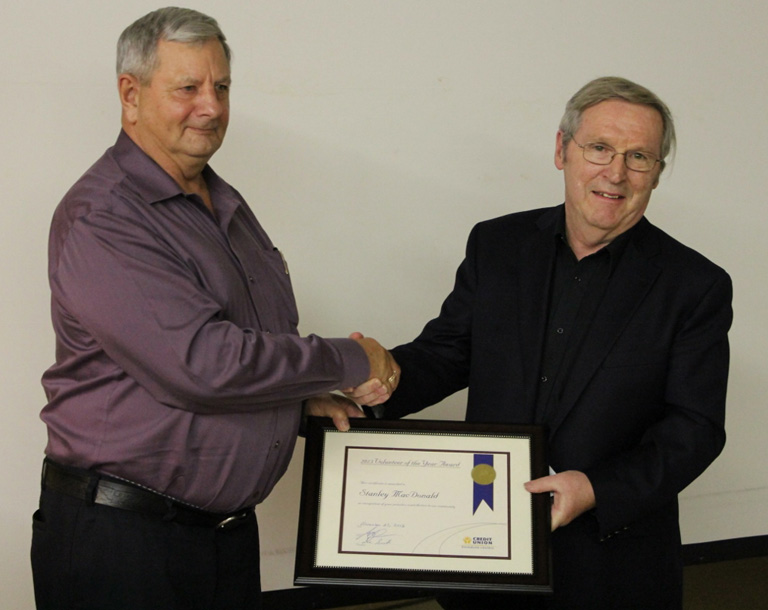 Board Member Eric Phillips (left) presents 2013 Volunteer of the Year Award to member Stanley MacDonald (right)